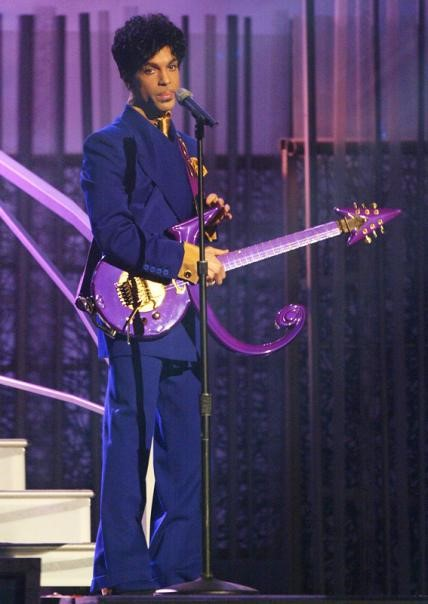Prince performed his classic song Purple Rain at the 46th Annual Grammy Awards in a full-on purple ensemble, including a matching guitar.